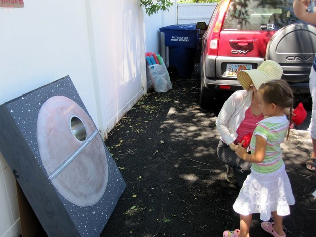Or use a cardboard box, some paint, and a few beanbags to make your own Death Star corn hole game.